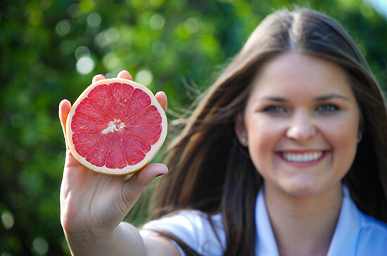 Sydney from IMGC holding a Florida Grapefruit